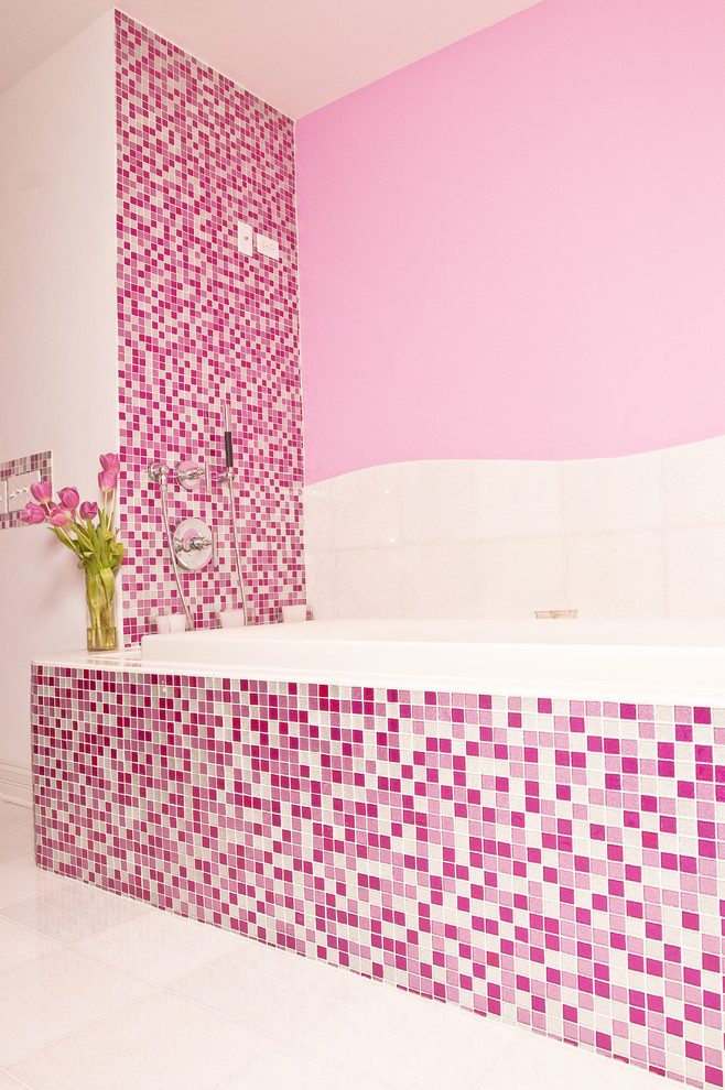 Bathroom - large contemporary pink tile and mosaic tile ceramic tile and white floor bathroom idea in New York with open cabinets, a one-piece toilet, pink walls, a wall-mount sink and glass countertops