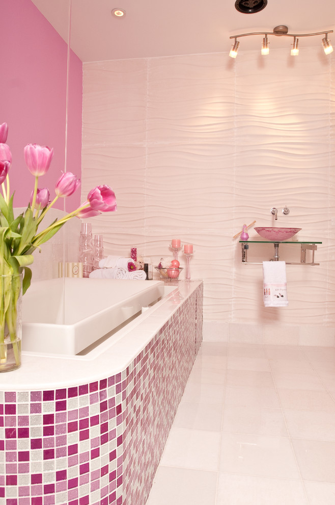 Example of a large trendy kids' mosaic tile and pink tile ceramic tile and white floor bathroom design in New York with pink walls, open cabinets, a one-piece toilet, a wall-mount sink and glass countertops