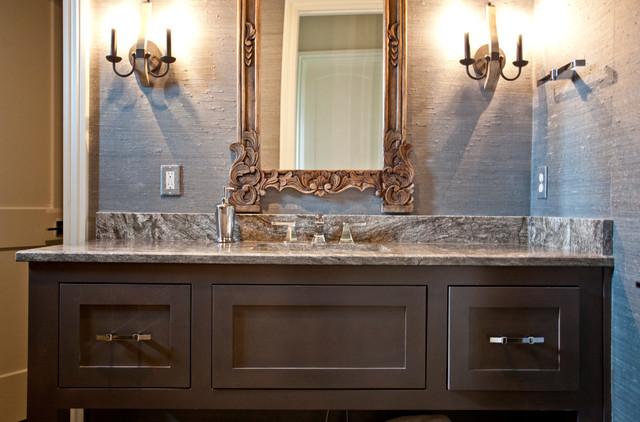 Bathroom - mid-sized mediterranean master beige tile bathroom idea in Other with recessed-panel cabinets, brown cabinets, an undermount sink, granite countertops and beige countertops