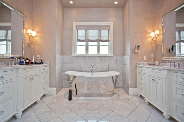 Example of a mid-sized transitional master beige tile and marble tile marble floor and white floor freestanding bathtub design with recessed-panel cabinets, white cabinets, an undermount sink, granite countertops and beige countertops