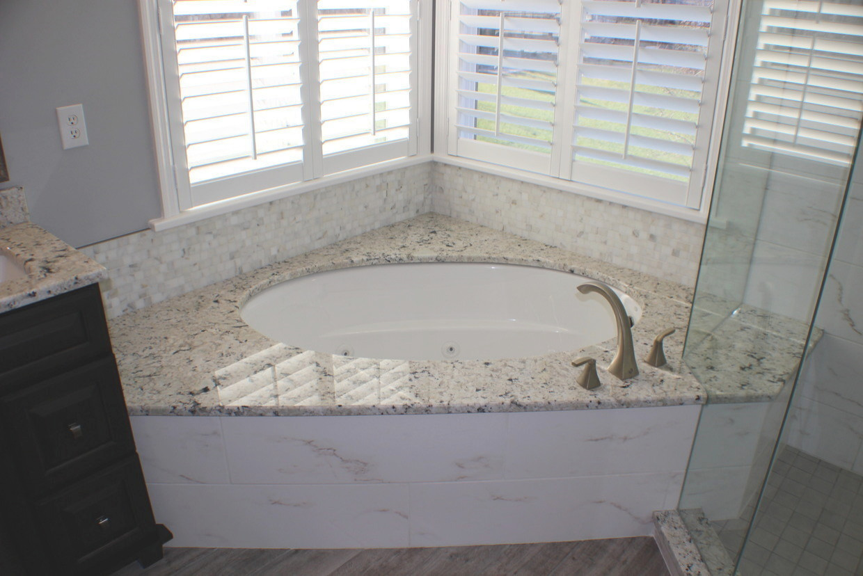 Plank and Marble Master Bath