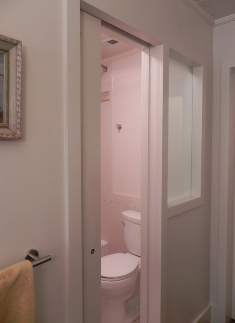 Pocket Door Frosted Window Separating Toilet In Narrow Bathroom Eclectic Bathroom Other Metro