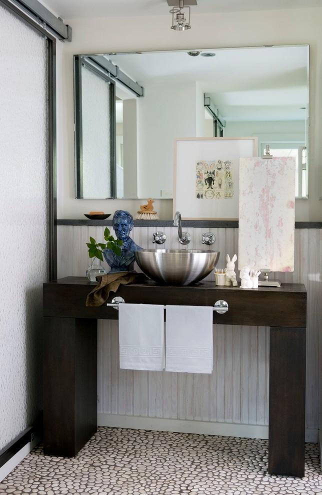 Trendy pebble tile floor bathroom photo in Philadelphia with a vessel sink and wood countertops