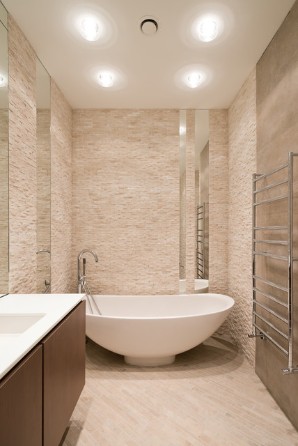 Inspiration for a contemporary freestanding bathtub remodel in Other with flat-panel cabinets, medium tone wood cabinets, beige walls and an undermount sink