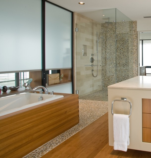 Polished amber pebble tile and master bath tiles for Trendy bathroom tiles