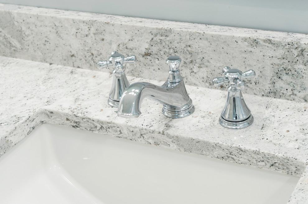 Polished chrome vanity faucet on Quartz countertop ...