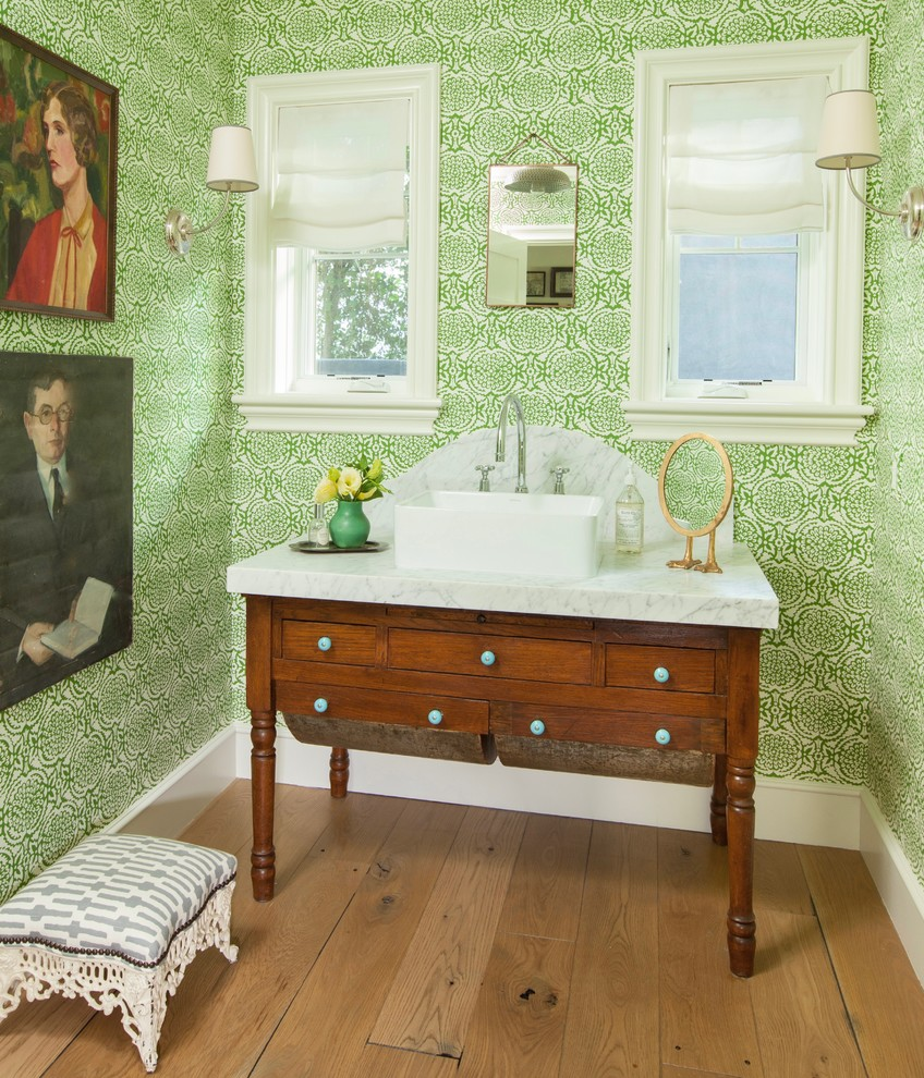 Mid-sized farmhouse light wood floor and brown floor bathroom photo in Los Angeles with dark wood cabinets, green walls, a vessel sink and marble countertops