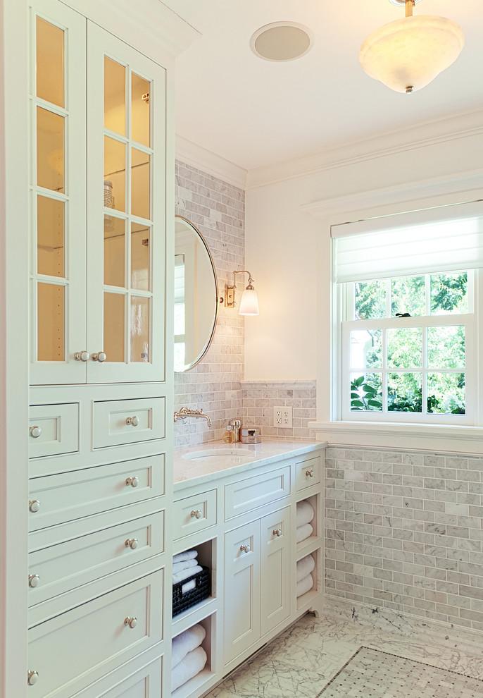 Bathroom - traditional white tile and stone tile bathroom idea in Minneapolis