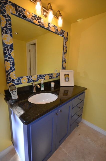 Inspiration for a mid-sized mediterranean 3/4 blue tile and ceramic tile travertine floor and beige floor alcove shower remodel in Austin with shaker cabinets, blue cabinets, a two-piece toilet, yellow walls, an undermount sink, granite countertops and a hinged shower door