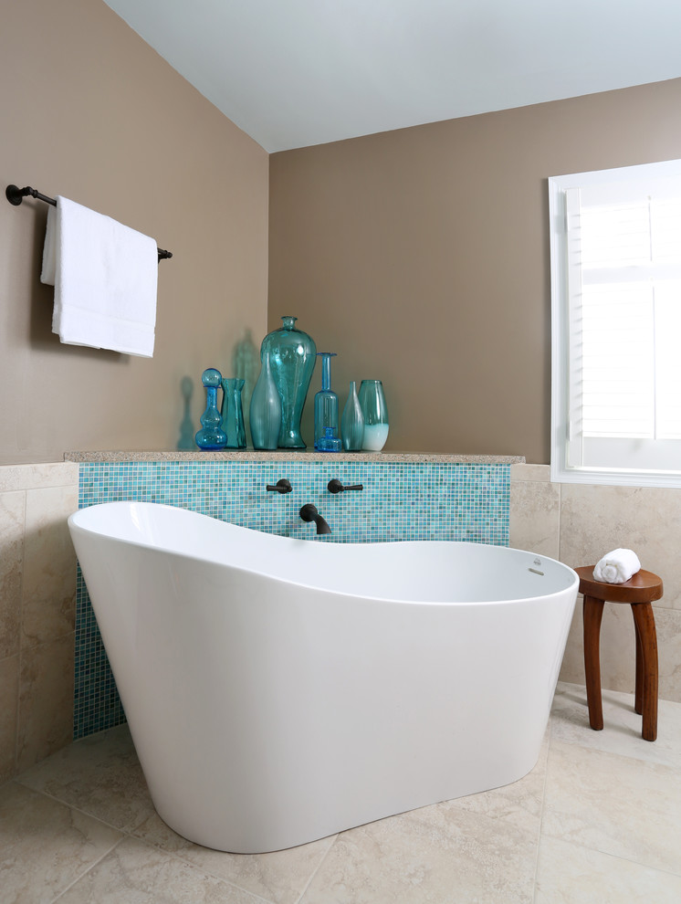 Mid-sized trendy master blue tile and mosaic tile freestanding bathtub photo in Chicago with beige walls