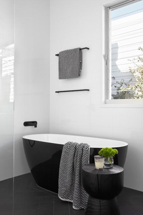 freestanding black and white bath