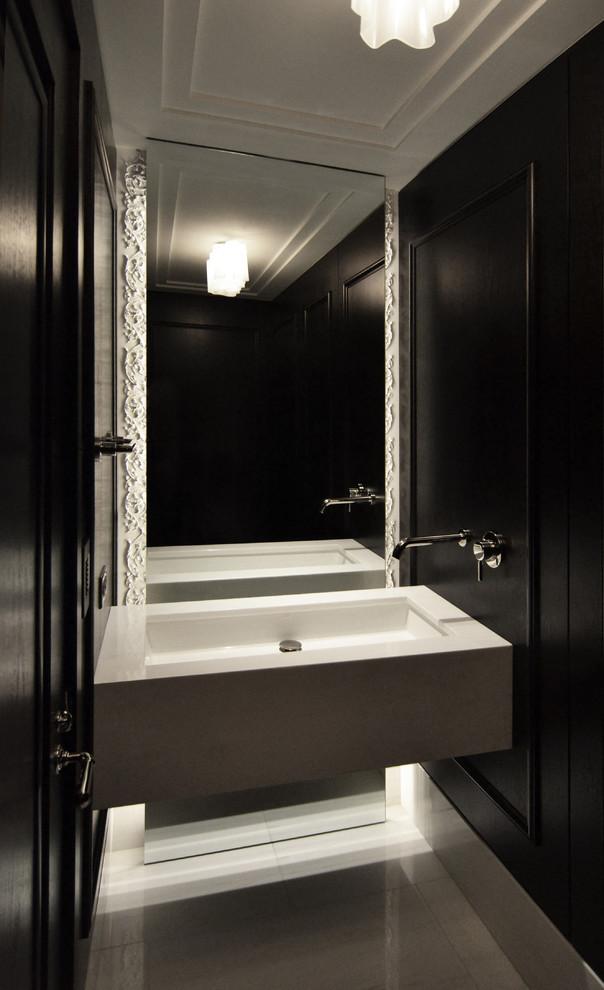Ispirazione per una piccola stanza da bagno design con lavabo sospeso, pareti nere e top in marmo