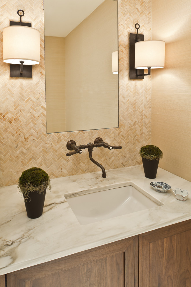 Bathroom - traditional beige tile and travertine tile bathroom idea in DC Metro with an undermount sink and dark wood cabinets