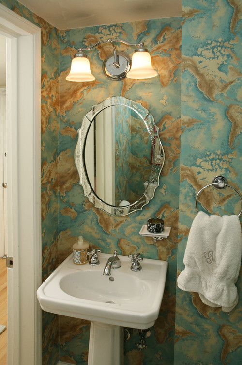 When should a powder room light fixture be placed over the mirror?