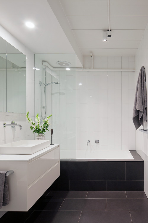 black and white bathroom with chrome tapware