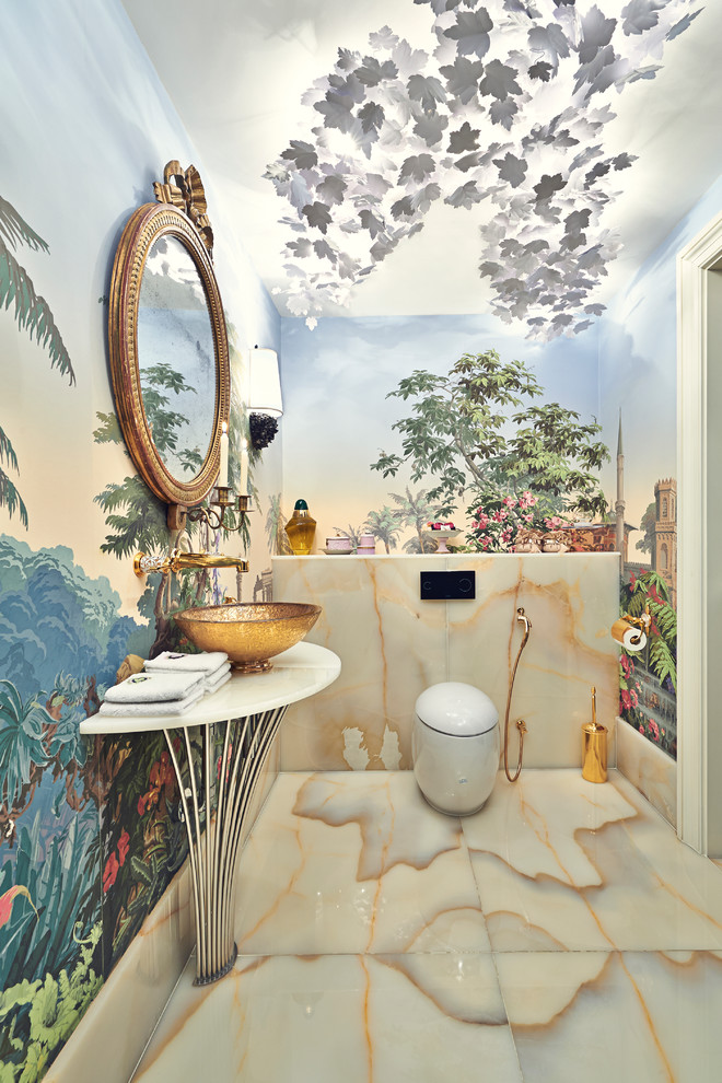 Example of a small eclectic stone slab bathroom design in Surrey