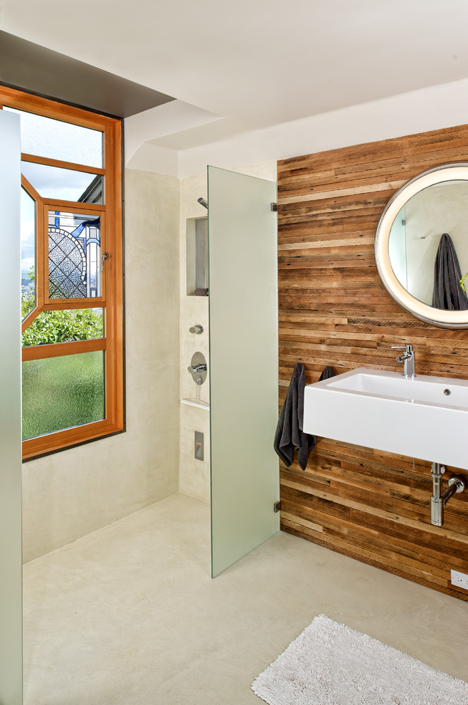 Inspiration for a contemporary bathroom remodel in Seattle with a wall-mount sink