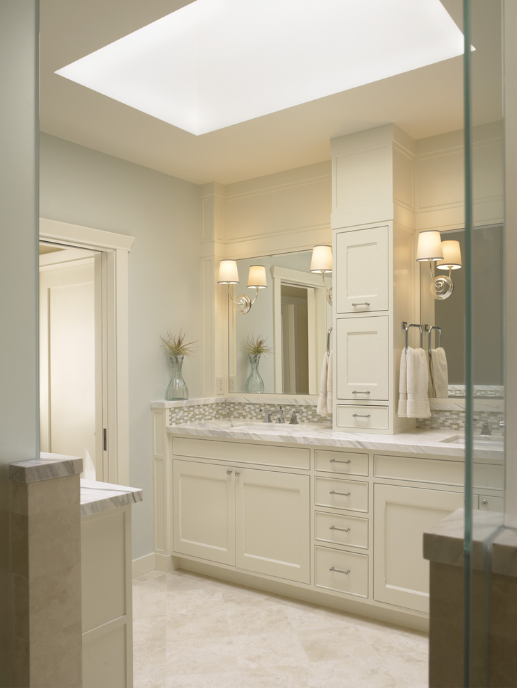 Example of a classic bathroom design in San Francisco with marble countertops