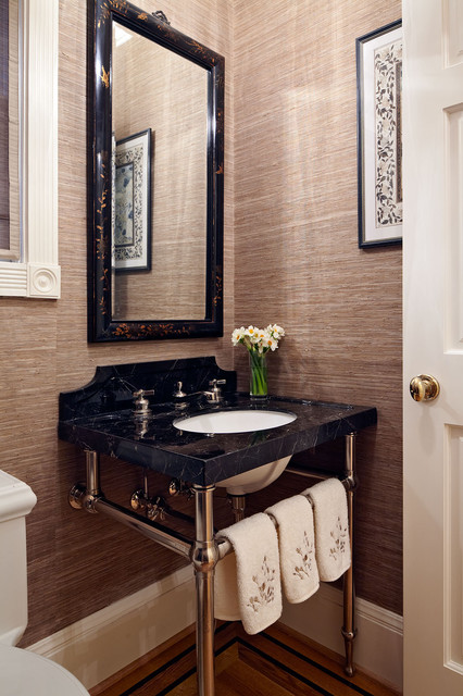 Elegant bathroom photo in San Francisco with a console sink and brown walls