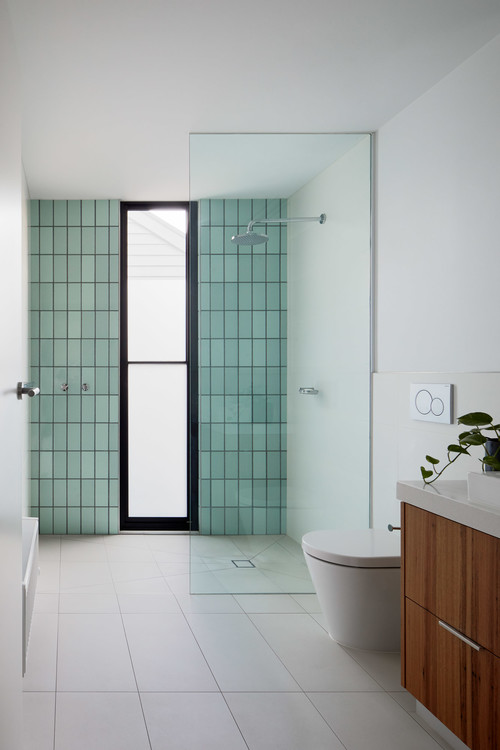 blue subway tile in bathroom