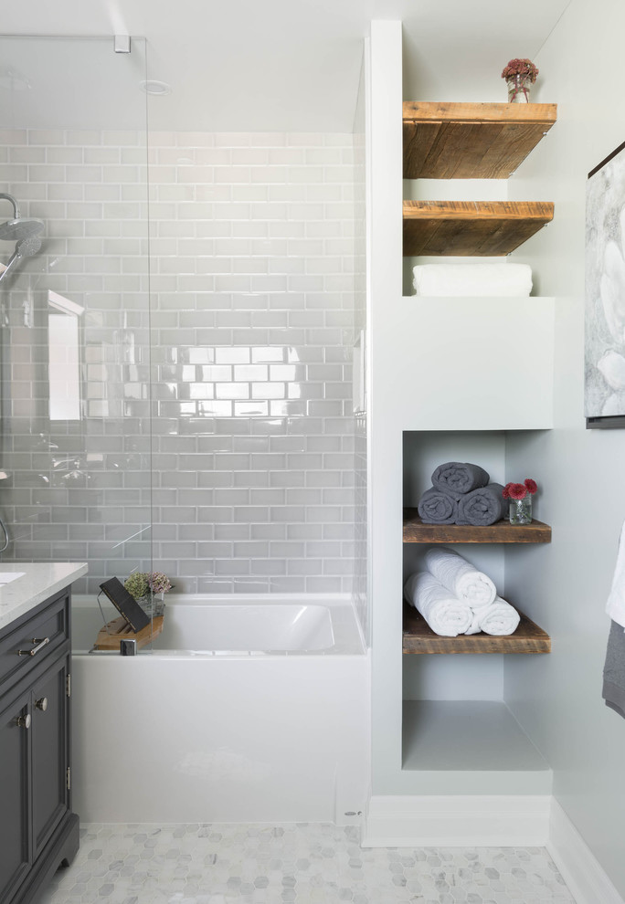 Bathroom - mid-sized contemporary master gray tile and subway tile marble floor and gray floor bathroom idea in Toronto with an undermount sink, recessed-panel cabinets, gray cabinets and gray walls