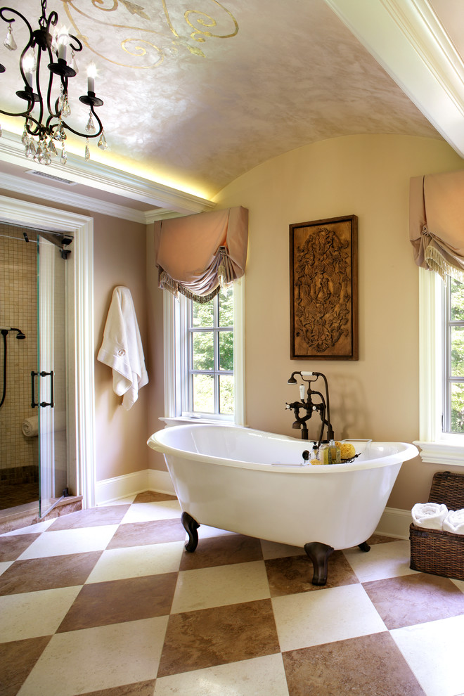 Bathroom - large traditional stone tile limestone floor bathroom idea in New York with an undermount sink and beige walls