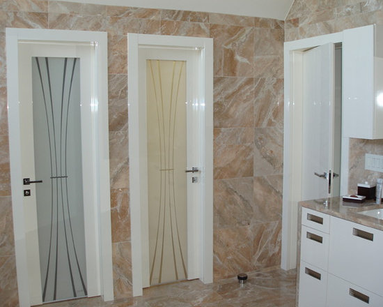 Private residence in Mill Neck, NY (Long Island) - Modern glossy interior door with glass.  Made in Italy.