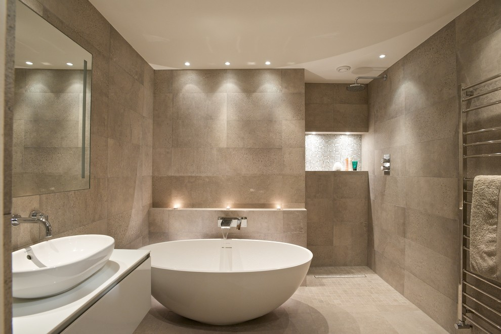 Trendy beige tile bathroom photo in London with a vessel sink, flat-panel cabinets, white cabinets and beige walls