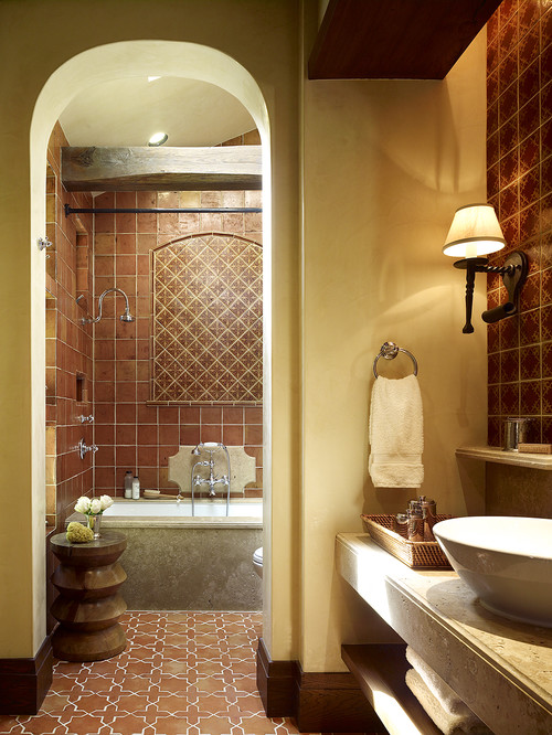 terracotta and cream bathroom with arch doorway