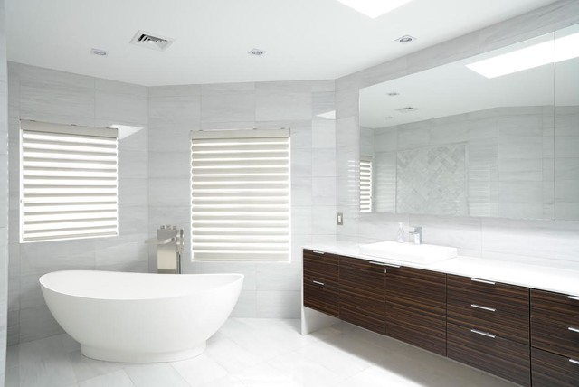 Bathroom - large modern master gray tile and marble tile marble floor and gray floor bathroom idea in New York with flat-panel cabinets, dark wood cabinets, solid surface countertops, white countertops, gray walls, a vessel sink and a hinged shower door