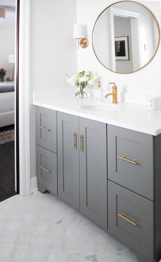 Inspiration for a small transitional 3/4 marble floor and gray floor bathroom remodel in Minneapolis with shaker cabinets, gray cabinets, a two-piece toilet, white walls, an undermount sink and quartz countertops