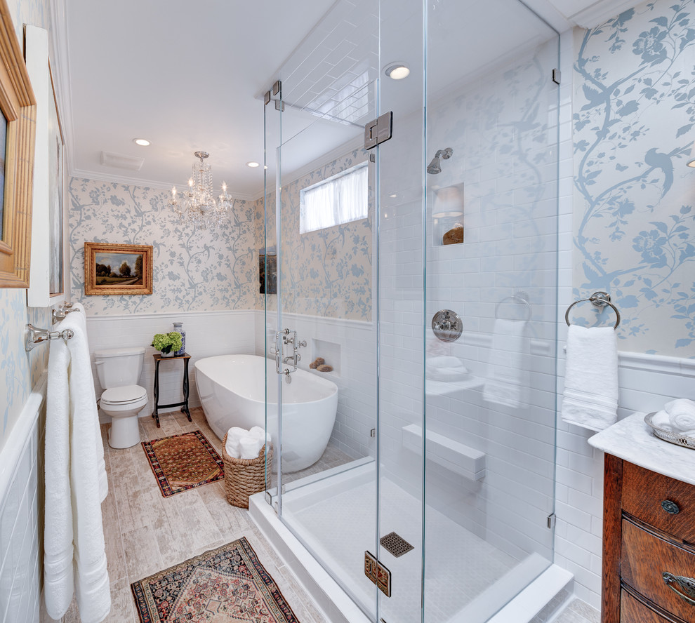 Example of a trendy master white tile light wood floor bathroom design in Los Angeles with a drop-in sink, flat-panel cabinets, medium tone wood cabinets and multicolored walls