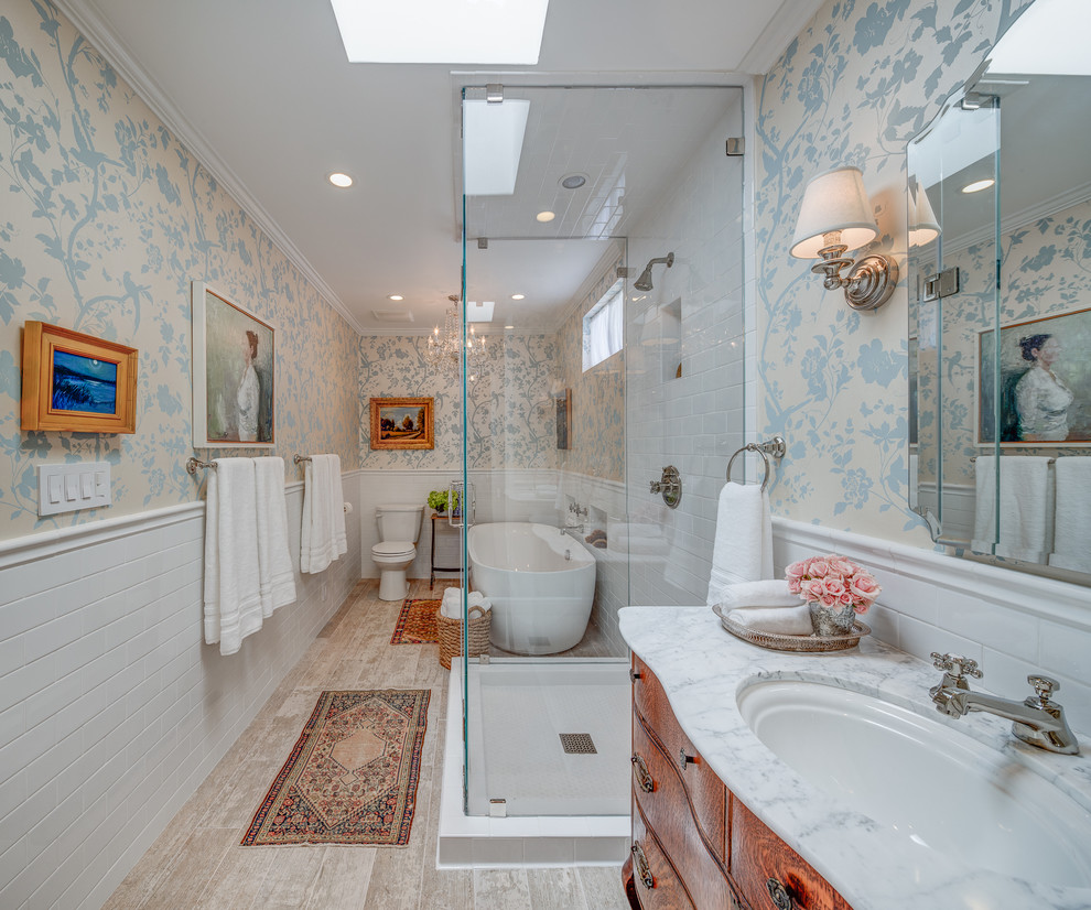 Trendy master white tile light wood floor bathroom photo in Los Angeles with a drop-in sink, flat-panel cabinets, medium tone wood cabinets and multicolored walls