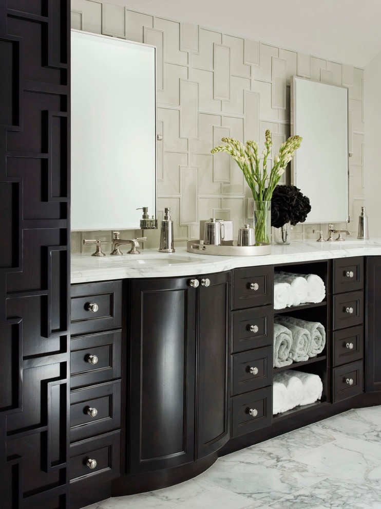 Example of a transitional white tile marble floor bathroom design in Los Angeles with white walls, an undermount sink, recessed-panel cabinets and dark wood cabinets