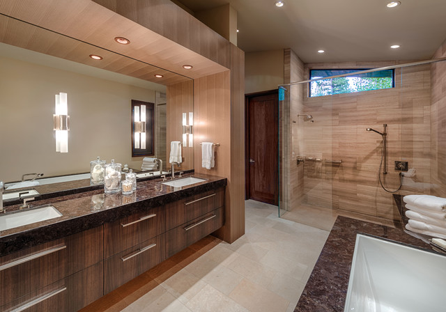 Inspiration for a contemporary beige tile walk-in shower remodel in Sacramento with an undermount sink, flat-panel cabinets, dark wood cabinets and brown countertops