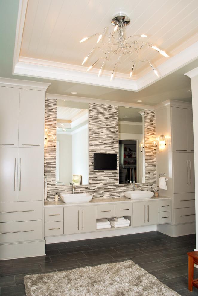 Bathroom - tropical bathroom idea in Charleston with a vessel sink