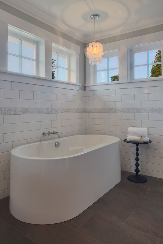 Inspiration for a timeless white tile and subway tile freestanding bathtub remodel in Vancouver