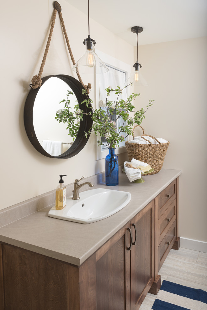 Inspiration for a coastal ceramic tile bathroom remodel in Ottawa with a drop-in sink, shaker cabinets, dark wood cabinets, beige walls and gray countertops