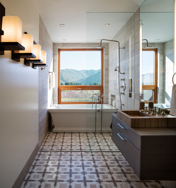 Trendy freestanding bathtub photo in Other with a vessel sink