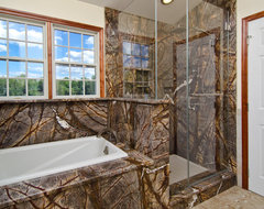 Rainforest Brown Granite vanity, tub surround, and shower wall eclectic-bathroom