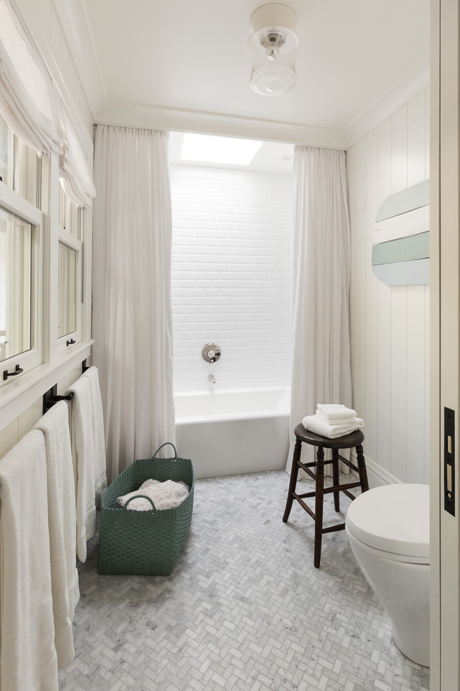 Mid-sized elegant kids' white tile and porcelain tile marble floor bathroom photo in San Francisco with medium tone wood cabinets, a one-piece toilet, white walls, an undermount sink and marble countertops