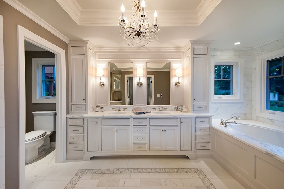Example of a classic master white tile and marble tile toilet room design in San Francisco with an undermount sink, shaker cabinets, white cabinets, marble countertops, an undermount tub and white countertops