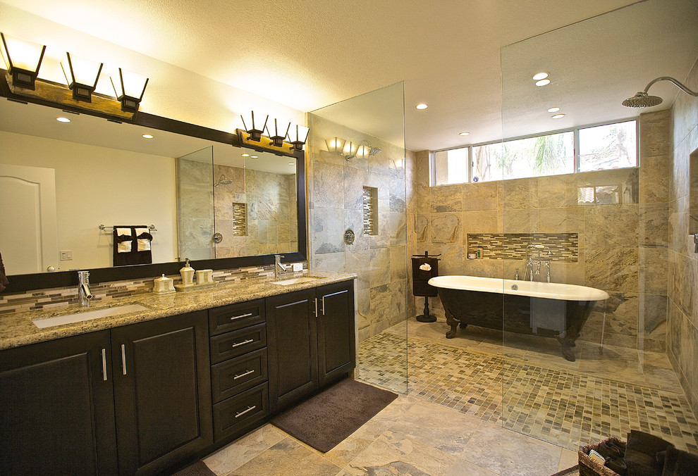 Bathroom - traditional beige tile bathroom idea in Other with an undermount sink, raised-panel cabinets and dark wood cabinets