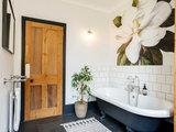 A Simple Bathroom Gets a Lift From Warm Wood and a Flower Mural (7 photos)
