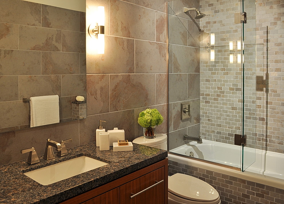 Example of a trendy bathroom design in Vancouver with granite countertops