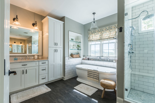 Large elegant master white tile and subway tile dark wood floor and brown floor bathroom photo in DC Metro with shaker cabinets, white cabinets, gray walls, an undermount sink, engineered quartz countertops, a hinged shower door and gray countertops