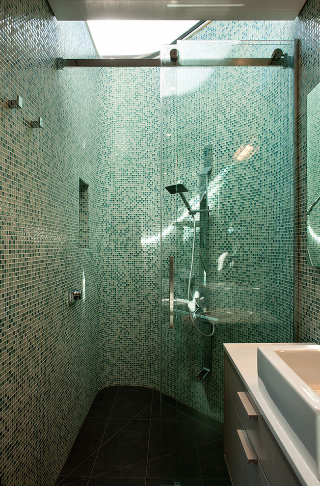 Inspiration for a small contemporary 3/4 green tile bathroom remodel in Wellington with flat-panel cabinets, green walls and a vessel sink