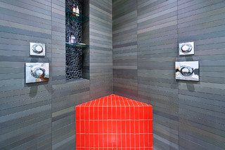 red bench and pebble niche modern-bathroom