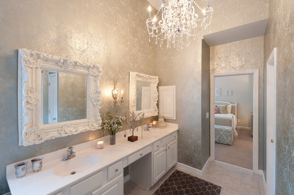 Example of an ornate gray tile bathroom design in DC Metro with an integrated sink, raised-panel cabinets, white cabinets and multicolored walls