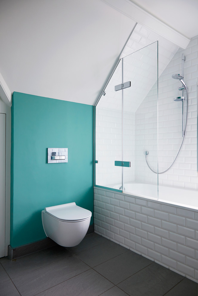 Inspiration for a transitional white tile and subway tile gray floor bathroom remodel in Surrey with a wall-mount toilet and green walls